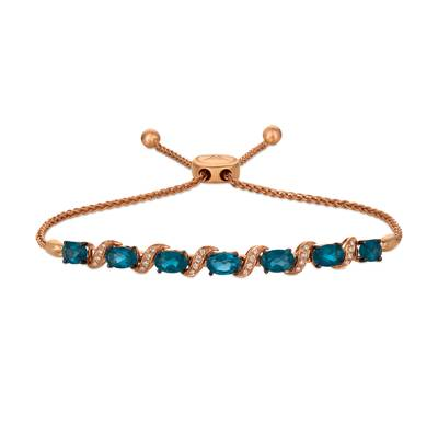 14K Strawberry Gold® Deep Sea Blue Topaz™ 2  7/8 cts. Bolo Bracelet with Vanilla Diamonds® 1/15 cts. | WASS 13LB